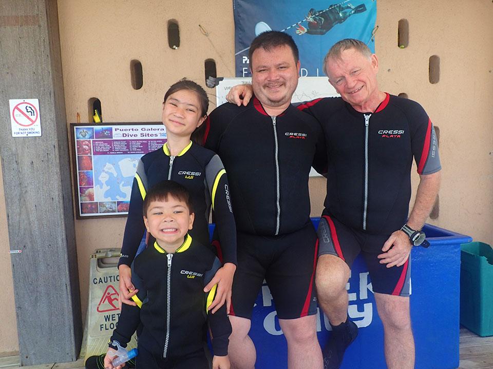 family scuba diving asia divers puerto galera